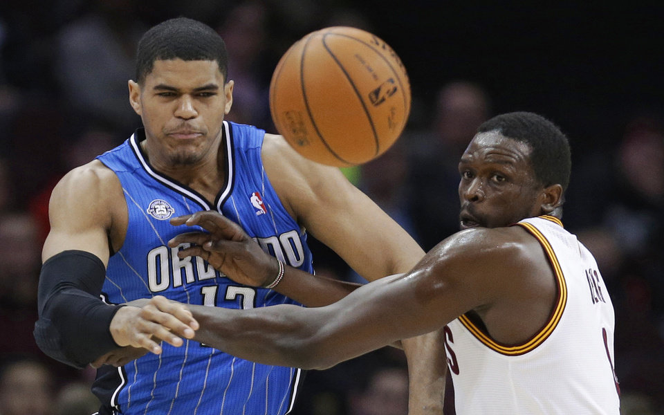 Photo - Orlando Magic's Tobias Harris, left, and Cleveland Cavaliers' Luol Deng watch the ball during the first quarter of an NBA basketball game Wednesday, Feb. 19, 2014, in Cleveland. (AP Photo/Tony Dejak)