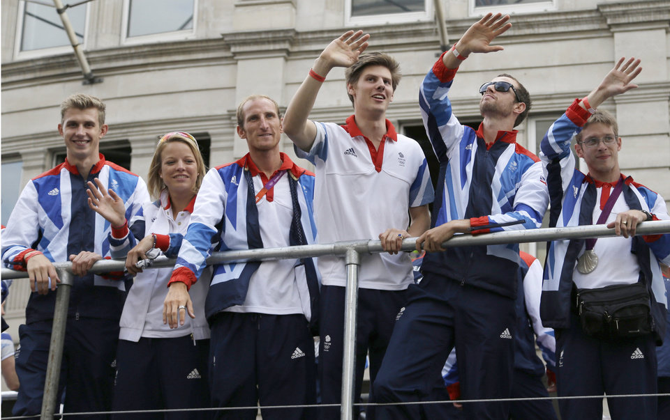 Photo -   Members of the Team GB Olympic and Paralympic teams parade in the streets of London, Monday, Sept. 10, 2012. Our Greatest Team Parade, the procession of athletes, celebrates the achievements of British Olympians and Paralympians at the London 2012 Games. (AP Photo/Lefteris Pitarakis)