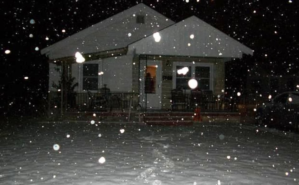 Snow falls on a house in Oklahoma. Contributed by Ashlea Robinson.
