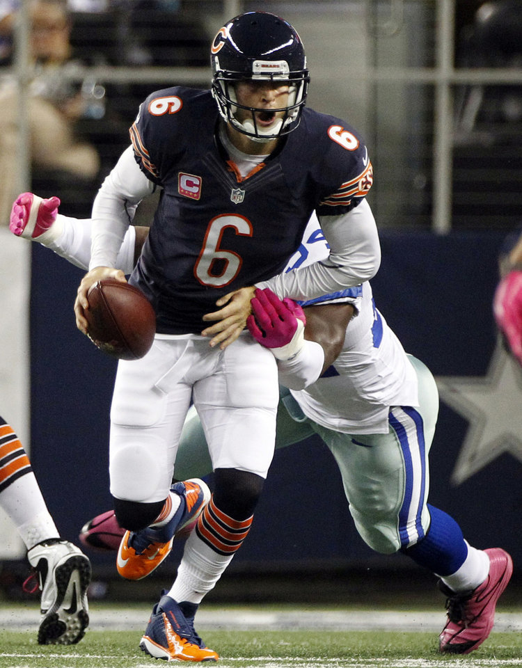 Photo -   Dallas Cowboys outside linebacker DeMarcus Ware (94) sacks Chicago Bears quarterback Jay Cutler (6) during the first half of an NFL football game, Monday, Oct. 1, 2012, in Arlington, Texas. (AP Photo/LM Otero)
