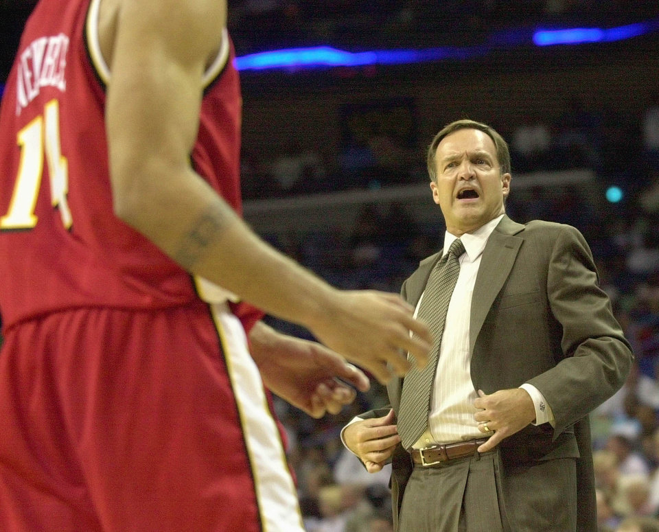 Former Atlanta Hawks coach Lon Kruger talks with Ira Newble (14) during second half action against the New Orleans Hornets in New Orleans Tuesday night Oct. 22, 2002. Kruger's team defeated the Hornets 95-87. (AP Photo/Bill Haber)