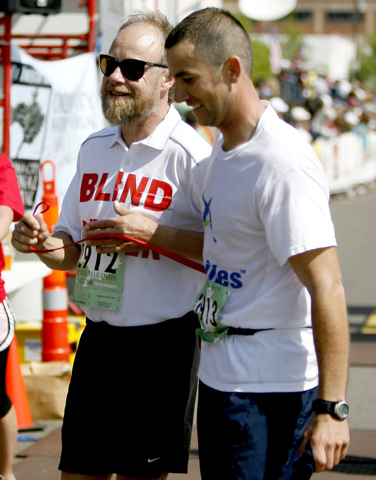 Blind runner Kerry Cook walks with his guide Matt Guidry after finishing the Oklahoma City Memorial Marathon, Sunday, April 27, 2008. BY BRYAN TERRY, THE OKLAHOMAN