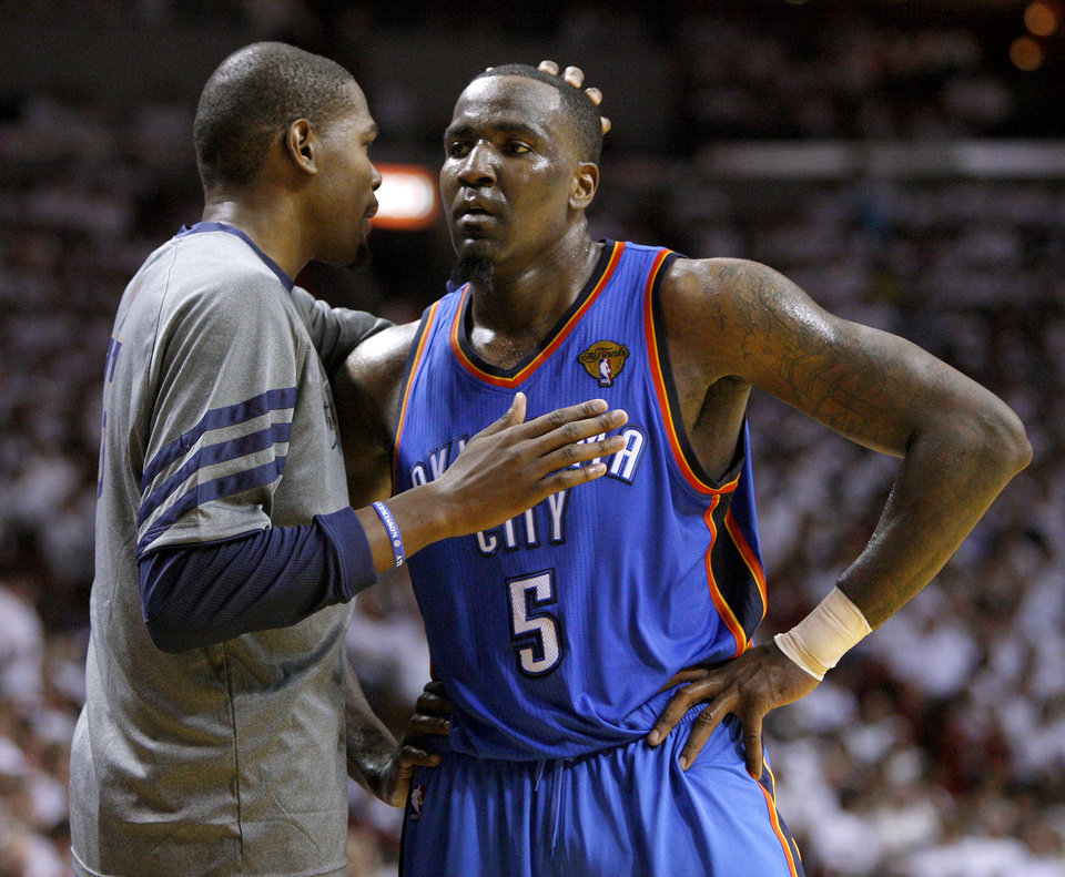 Photo - Oklahoma City's Kevin Durant, left, talks with Oklahoma City's Kendrick Perkins (5) during Game 3 of the NBA Finals between the Oklahoma City Thunder and the Miami Heat at American Airlines Arena, Sunday, June 17, 2012. Oklahoma City lost 91-85.  Photo by Bryan Terry, The Oklahoman