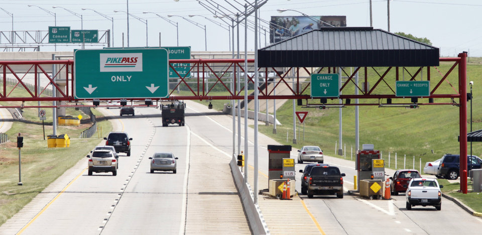 Photo - Drivers pass through the toll gate on the Kilpatrick Turnpike near Western Avenue in Oklahoma City, Wednesday, April  25,  2012. Photo By Steve Gooch, The Oklahoman  Steve Gooch - The Oklahoman
