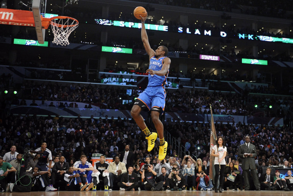 Oklahoma City Thunder's Serge Ibaka dunks during the Slam Dunk Contest at the NBA basketball All-Star weekend, Saturday, Feb. 19, 2011, in Los Angeles.  (AP Photo/Mark J. Terrill)