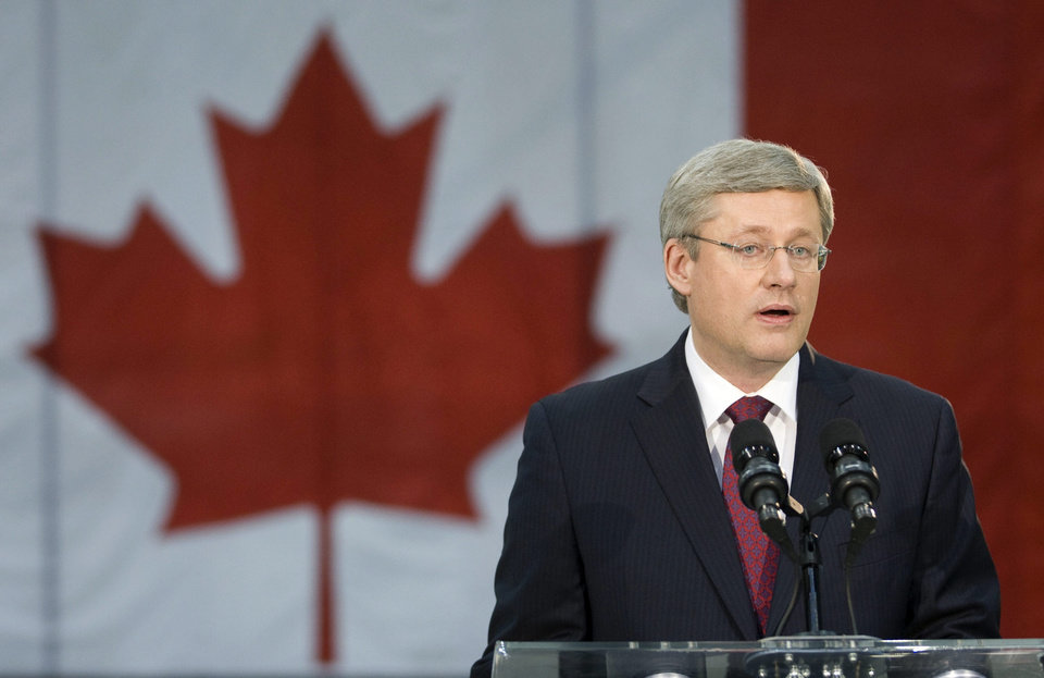 Photo - Prime Minister Stephen Harper comments on the death of Osama bin Laden, the mastermind behind the Sept. 11 attacks against the United States, following U.S. President Barack Obama's announcement, in Abbotsford, B.C. on Sunday May 1, 2011. (AP Photo/The Canadian Press, Adrian Wyld) ORG XMIT: AJW201
