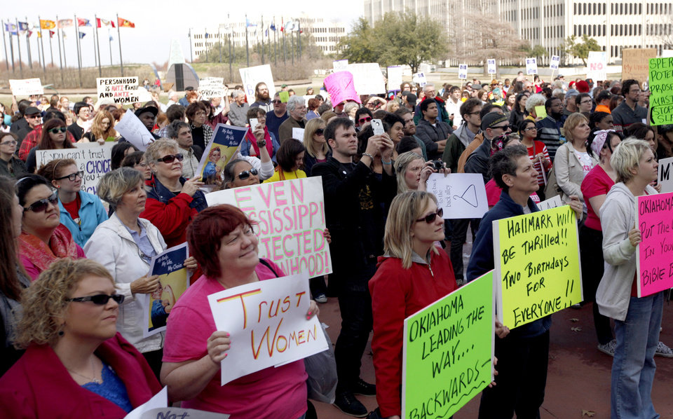 Photo - People attend a rally opposing the Personhood measures at the state Capitol, Tuesday, Feb. 28, 2012. Photo by Sarah Phipps, The Oklahoman