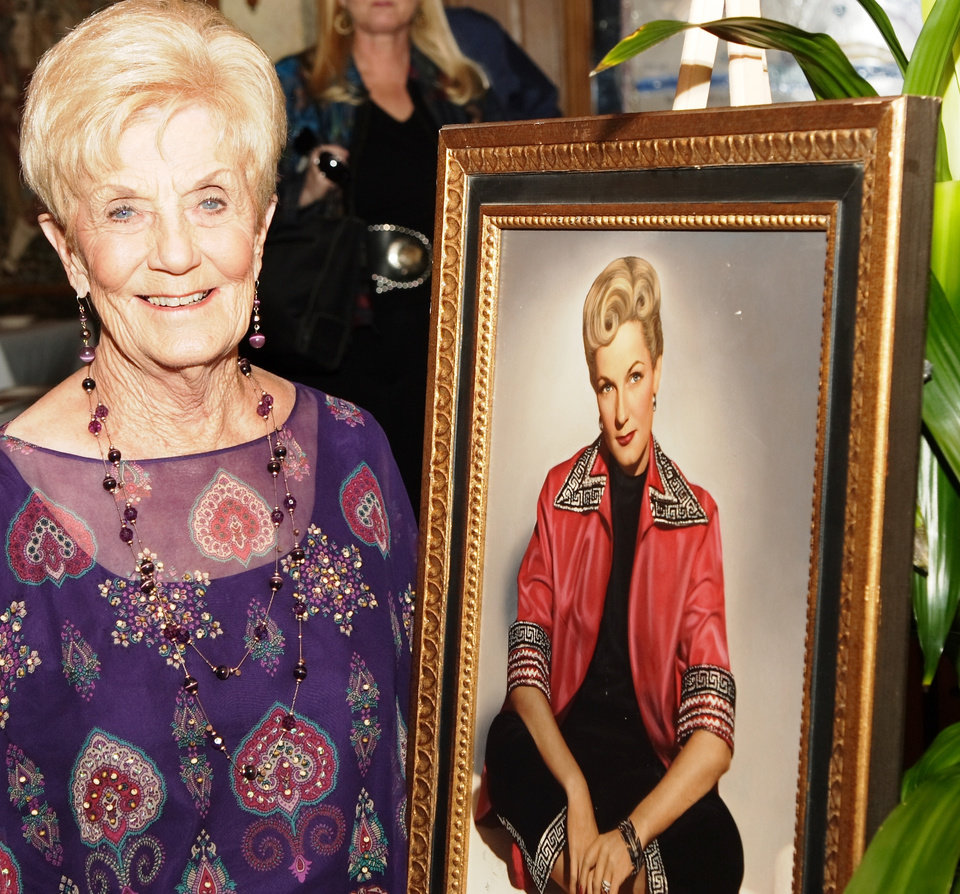 Levita Anderson and a portrait from her youth at her 80th birthday party.