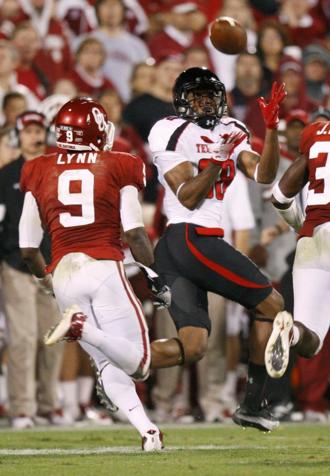 Texas Tech's Marcus Kennard (88) catches a pass in front of Oklahoma's Gabe Lynn (9) during the college football game between the University of Oklahoma Sooners (OU) and the Texas Tech University Red Raiders (TTU) at Gaylord Family-Oklahoma Memorial Stadium in Norman, Okla., Saturday, Oct. 22, 2011. Oklahoma lost 41-38. Photo by Bryan Terry, The Oklahoman