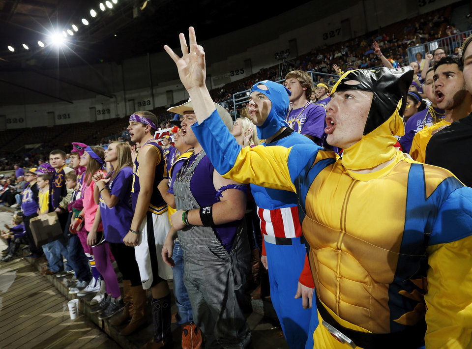 Okarche student Wyatt Carter, 17, cheers in a Wolverine costume with other fans during a Class A Girls semifinal game of the state high school basketball tournament between Okarche and Turner at Jim Norick Arena, The Big House, on State Fair Park in Oklahoma City, Friday, March 1, 2013.Okarche won, 62-24. Photo by Nate Billings, The Oklahoman