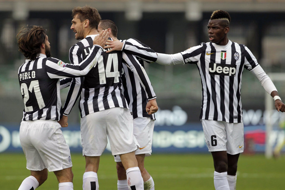 Photo - Juventus' Fernando Lloriente, second left, celebrates with teammates Andrea Pirlo, left, Giorgio Chiellini, center, and Paul Pogba after scoring, during a Serie A soccer match between Juventus and Cagliari, in Cagliari, Italy, Sunday, Jan. 12, 2013. (AP Photo/Str)