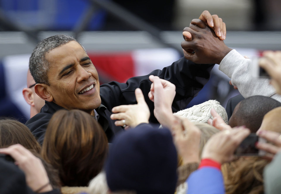 President Barack Obama greets supporters after speaking at a campaign event near the State Capitol Building in Madison, Wis., Monday, Nov. 5, 2012. (AP Photo/Pablo Martinez Monsivais)