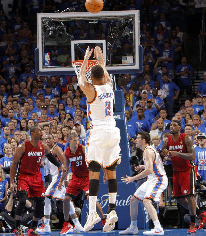 Oklahoma City's Thabo Sefolosha (2) puts up a shot during Game 1 of the NBA Finals between the Oklahoma City Thunder and the Miami Heat at Chesapeake Energy Arena in Oklahoma City, Tuesday, June 12, 2012. Photo by Chris Landsberger, The Oklahoman