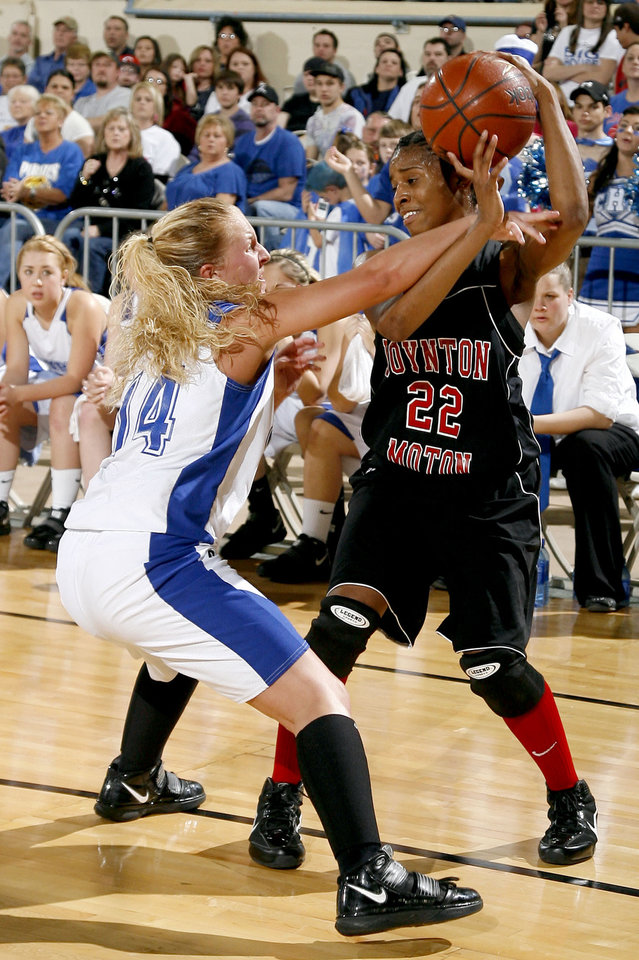 Photo - BOYNTON-MOTON / GIRLS HIGH SCHOOL BASKETBALL: Boynton's Breanna Hutchinson (22) looks to pass as Cyril's Shelbie Laughlin defends during finals of girls Class B basketball state tournament  between Cyril and Boynton at the State Fair Arena, Saturday, March 6, 2010, in Oklahoma City. Photo by Sarah Phipps, The Oklahoman  ORG XMIT: KOD