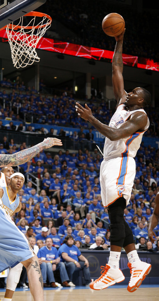 Photo - Oklahoma City's Kendrick Perkins (5) shoots the ball during the NBA basketball game between the Denver Nuggets and the Oklahoma City Thunder in the first round of the NBA playoffs at the Oklahoma City Arena, Sunday, April 17, 2011. Photo by Bryan Terry, The Oklahoman