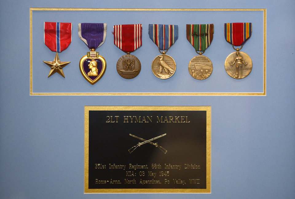 A plaque that contains medals, from left, the Bronze Star, the Purple Heart, the Army Good Conduct Medal, American Campaign Medal, European-African-Middle Eastern Campaign Medal and the World War II Victory Medal are seen after they were presented to Hyla Merin along with a Silver Star by Army Capt. Zachariah L. Fike, Sunday, Feb. 17, 2013, during a ceremony at her home in Thousand Oaks, Calif. The medals were presented posthumously to her father after recently being discovered in an apartment where Merin\'s mother and aunts had once lived. (AP Photo/Mark J. Terrill)