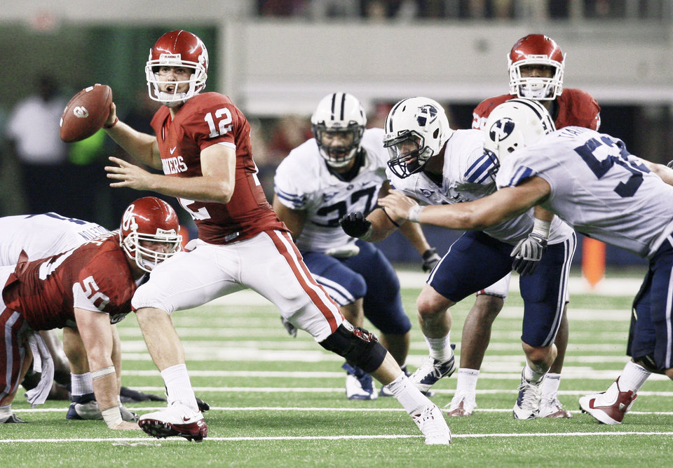 Photo - Landry Jones didn't win in his first appearance this season against BYU but could become a legend if he can lead the Sooners to a win at Miami. AP Photo
