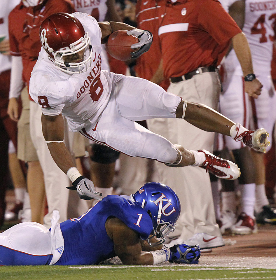 Oklahoma's Dominique Whaley (8) is upended by Kansas' Lubbock Smith (1) during the college football game between the University of Oklahoma Sooners (OU) and the University of Kansas Jayhawks (KU) on Saturday, Oct. 15, 2011. in Lawrence, Kan. Photo by Chris Landsberger, The Oklahoman