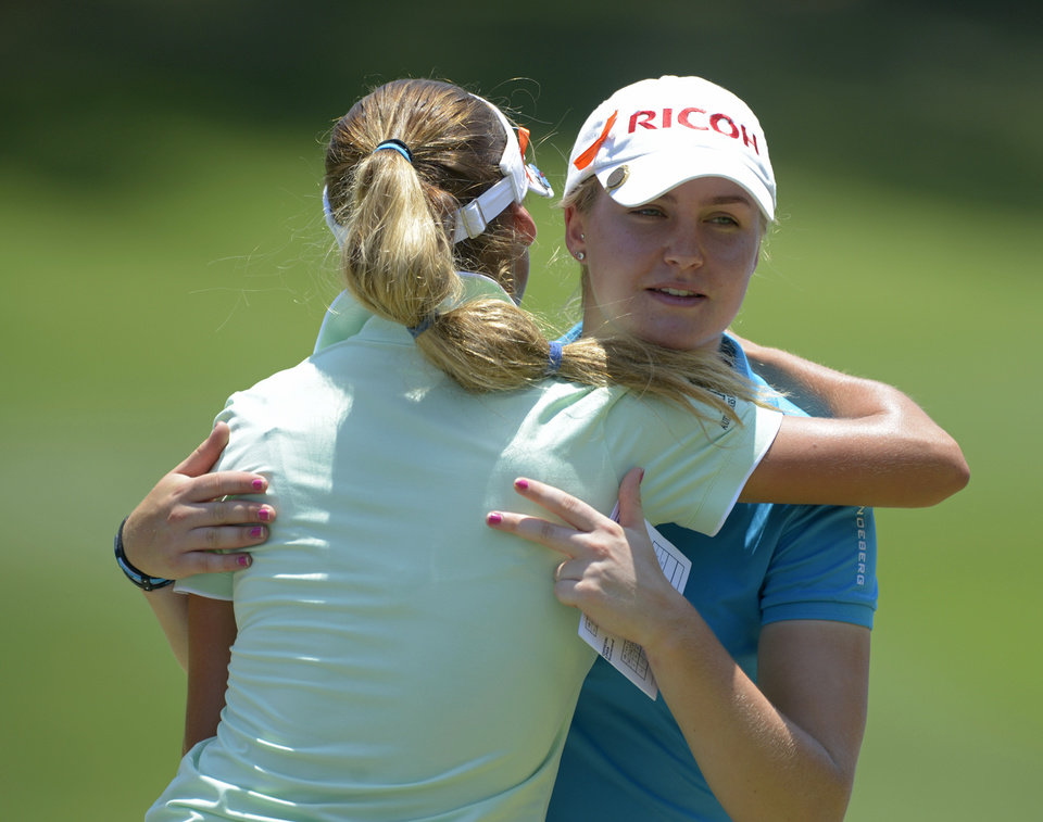 Photo - Charley Hull of England, facing camera, hugs Belen Mozo of Spain after their group completes play on the ninth hole during the second round of the Airbus LPGA Classic golf tournament at Magnolia Grove on Friday, May 23, 2014, in Mobile, Ala. (AP Photo/G.M. Andrews)
