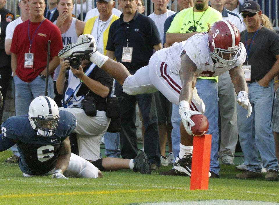 Alabama running back Trent Richardson (3) reaches for the pylon as he leaps for the end zone past Penn State linebacker Gerald Hodges (6) in the fourth quarter of an NCAA football game on Saturday, Sept. 10, 2011, in State College, Pa. Richardson was ruled out-of-bounds at the one-yard line. Alabama won 27-11. (AP Photo/Keith Srakocic)