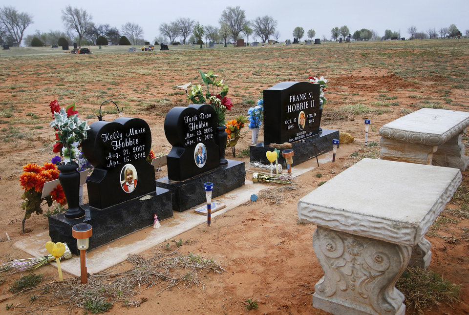 Burial site of a father and his two daughters who were killed in the tornado. Frank Hobbie II and daughters Kelly Marie and Faith Dean are buried side-by-side on the north edge of Elmwood Cemetery in Woodward. Residents of Woodward, in northwest Oklahoma, observe the first anniversary of a deadly F3 tornado that caused serious damage and killed six people on April 15, 2012.   Photo taken Tuesday, April 9, 2013.  by Jim Beckel, The Oklahoman.