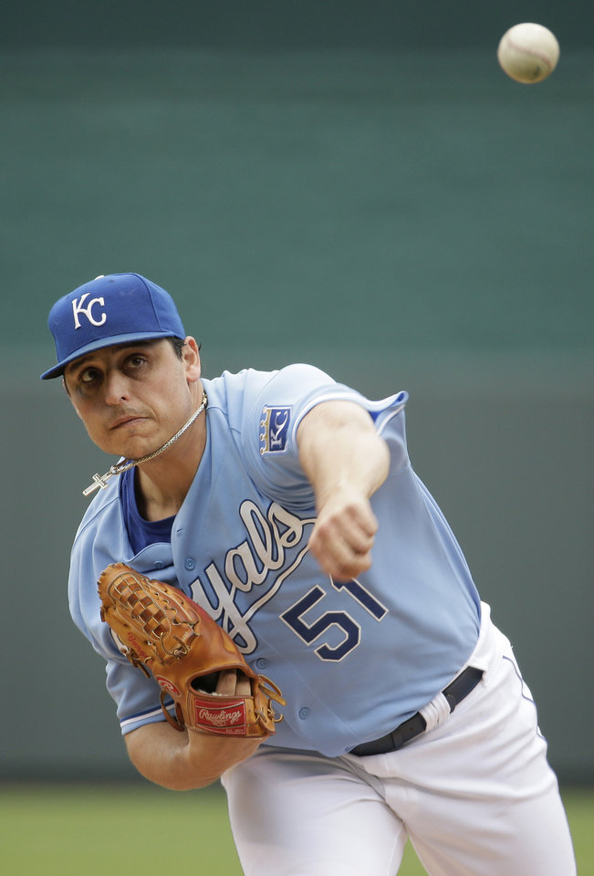 Photo - Kansas City Royals starting pitcher Jason Vargas throws during the first inning of a baseball game against the Colorado Rockies Wednesday, May 14, 2014 in Kansas City, Mo. (AP Photo/Charlie Riedel)