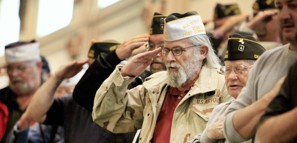 Photo - Air Force veteran Lynn Thompson, of Tuttle, salutes the flag Thursday during 2011 Veterans Awareness Day at the Capitol. Photo by Paul B. Southerland, The Oklahoman