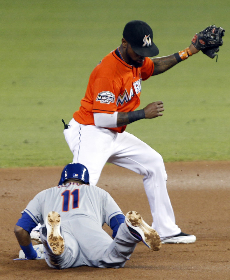 New York Mets' Ruben Tejada (11) returns safely into second base on a line drive to first base by Daniel Murphy as as Miami Marlins shortstop Jose Reyes, top, is late on the play during the first inning of a baseball game in Miami, Wednesday, Oct. 3, 2012. (AP Photo/Alan Diaz)