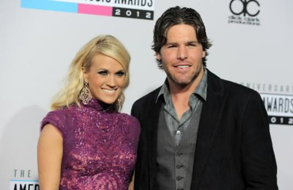 Photo -  Carrie Underwood and her husband, Mike Fisher, arrive at the show.