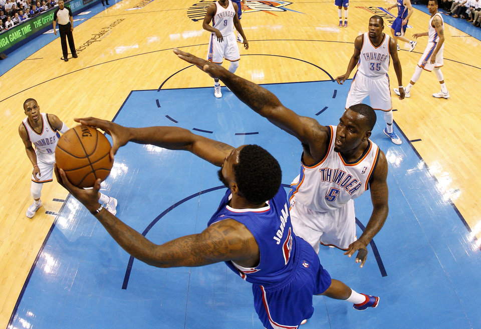Photo - Oklahoma City's Kendrick Perkins (5) defends Los Angeles' DeAndre Jordan (6) during Game 5 of the Western Conference semifinals in the NBA playoffs between the Oklahoma City Thunder and the Los Angeles Clippers at Chesapeake Energy Arena in Oklahoma City, Tuesday, May 13, 2014. Photo by Bryan Terry, The Oklahoman