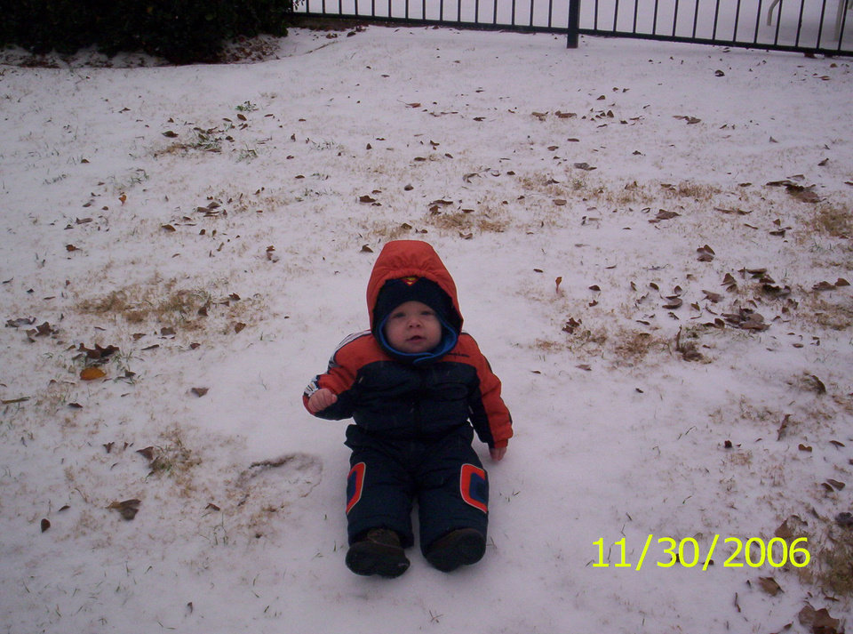 Ryan is playing in the snow. He is 9 months old and this is the first time he has ever seen snow!!!<br/><b>Community Photo By:</b> Holly Bittner<br/><b>Submitted By:</b> HOLLY, NORMAN