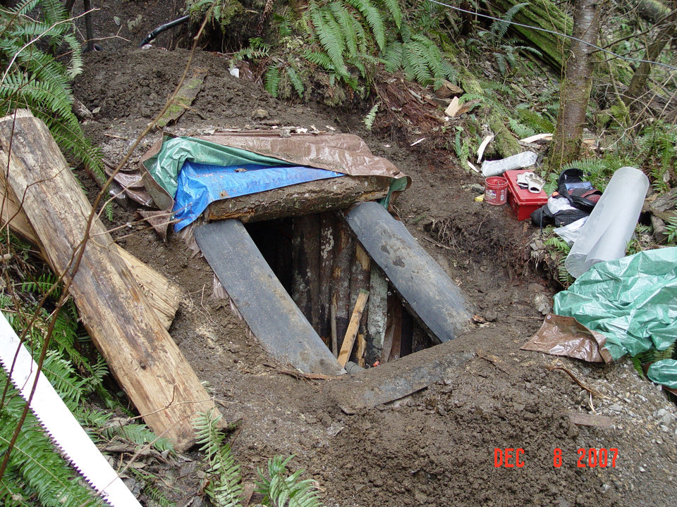 Photo -   This photo provided by the King County Sheriff's Department on Friday, April 27, 2012 shows a bunker that deputies say belongs to a man suspected of killing his wife and daughter, and holing up for days in the Cascade foothills east of Seattle. King County Sheriff's Sgt. Cindi West says photos found in Peter A. Keller's home helped them find the bunker Friday morning. (AP Photo/King County Sheriff's Department)