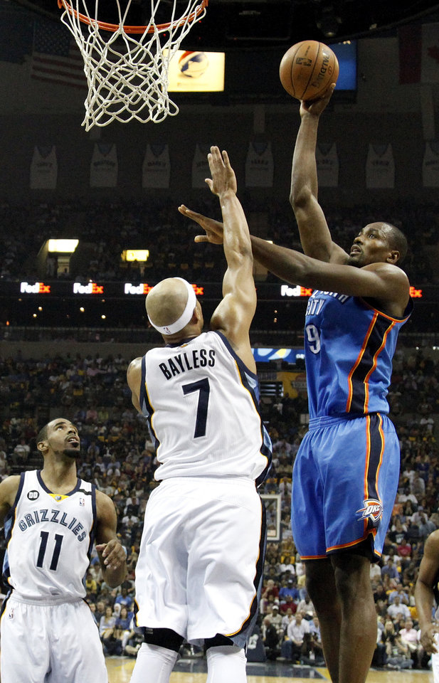 Oklahoma City's Serge Ibaka (9) shoots against Memphis' Jerryd Bayless (7) as Mike Conley (11) looks on during Game 3 in the second round of the NBA basketball playoffs between the Oklahoma City Thunder and Memphis Grizzles at the FedExForum in Memphis, Tenn.,  Saturday, May 11, 2013. Photo by Nate Billings, The Oklahoman