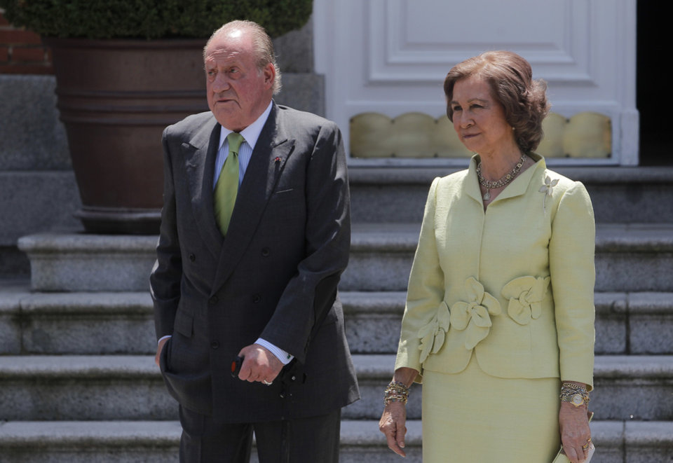 Photo - FILE - In this Tuesday, June 11, 2013, file photo, Spain's King Juan Carlos, and Spain's Queen Sofia, second right, gesture as they wait for Japan's Crown Prince Naruhito, unseen, during a meeting at the Zarzuela Palace, in Madrid. Spain's King Juan Carlos plans to abdicate and pave the way for his son, Crown Prince Felipe, to take over, Spanish Prime Minister Mariano Rajoy told the country Monday in an announcement broadcast nationwide. The 76-year-old Juan Carlos oversaw his country's transition from dictatorship to democracy but has had repeated health problems in recent years. (AP Photo/Andres Kudacki, File)