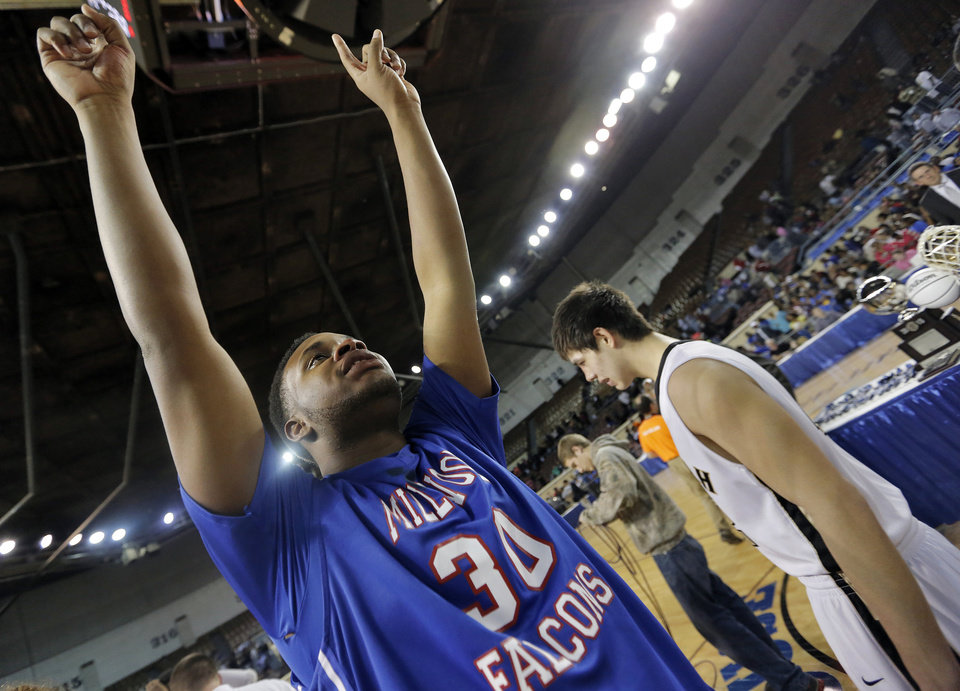 Photo - Millwood's Emmanuel Cole (30) reacts after the win over Okemah during the state high school basketball tournament Class 3A boys championship game between Millwood High School and Okemah High School at the State Fair Arena on Saturday, March 9, 2013, in Oklahoma City, Okla. Photo by Chris Landsberger, The Oklahoman