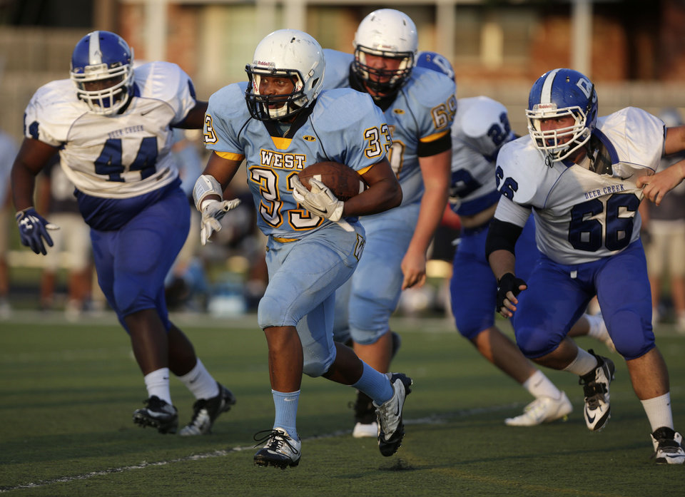 Photo - Putnam City West's Terrell Tisdale (33) runs the ball during a scrimmage at Putnam City West High School in Bethany, Thursday, Aug. 21, 2014.  Photo by Garett Fisbeck, For The Oklahoman