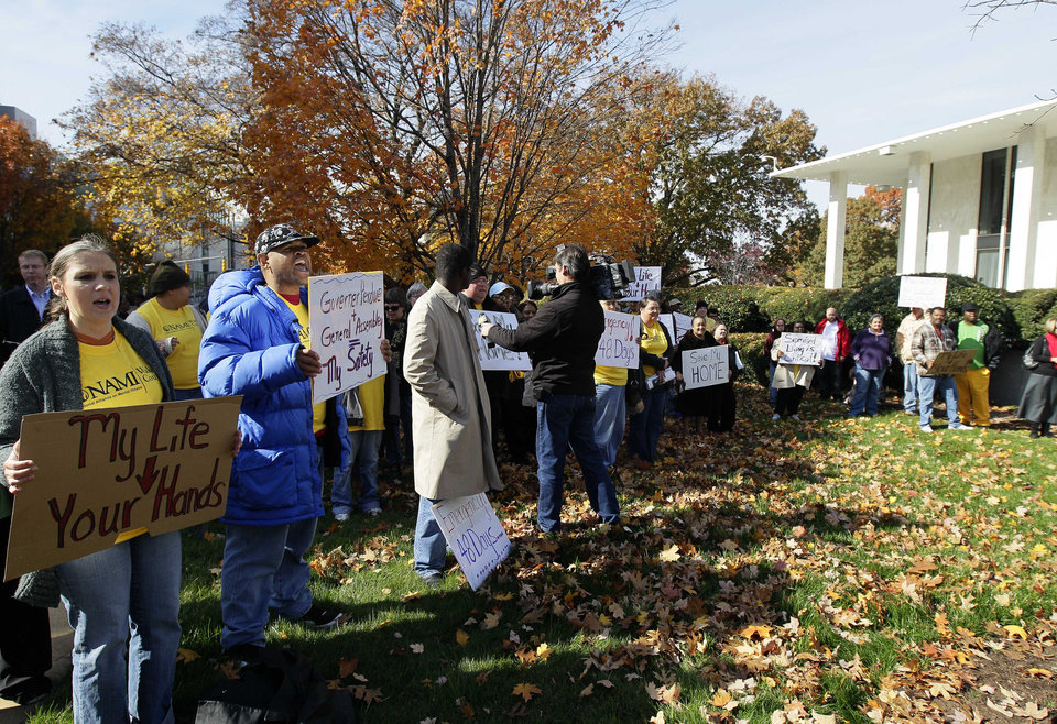 Supporters of the National Alliance on Mental Illness of Wake County, including group home residents, owners, and mental health advocates, rally at the Legislative office building in Raleigh, N.C., Wednesday, Nov. 14, 2012. Advocates are blaming legislators for a change that means the severely mentally ill in group homes may end up with nowhere to live because of an issue involving Medicaid payments. (AP Photo/Gerry Broome)