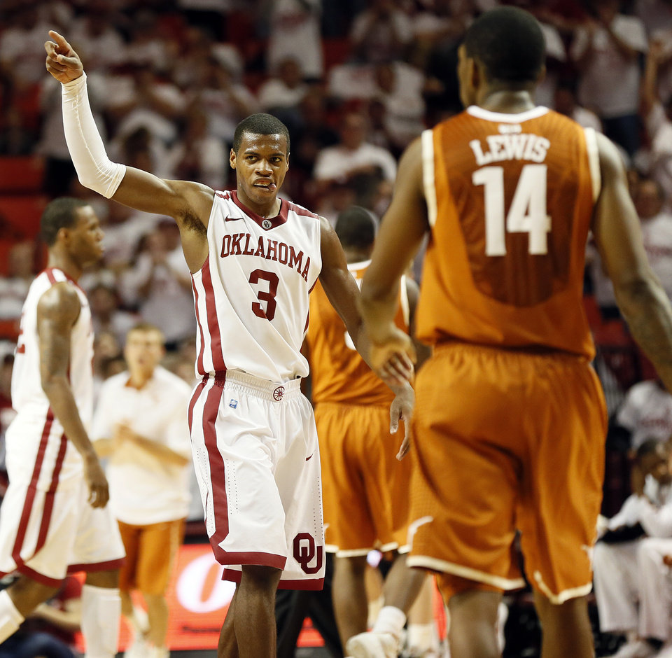 Photo - Oklahoma's Buddy Hield (3) celebrates in front of Texas' Julien Lewis (14) during a men's college basketball game between the University of Oklahoma and the University of Texas at the Lloyd Noble Center in Norman, Okla., Monday, Jan. 21, 2013. OU won, 73-67. Photo by Nate Billings, The Oklahoman