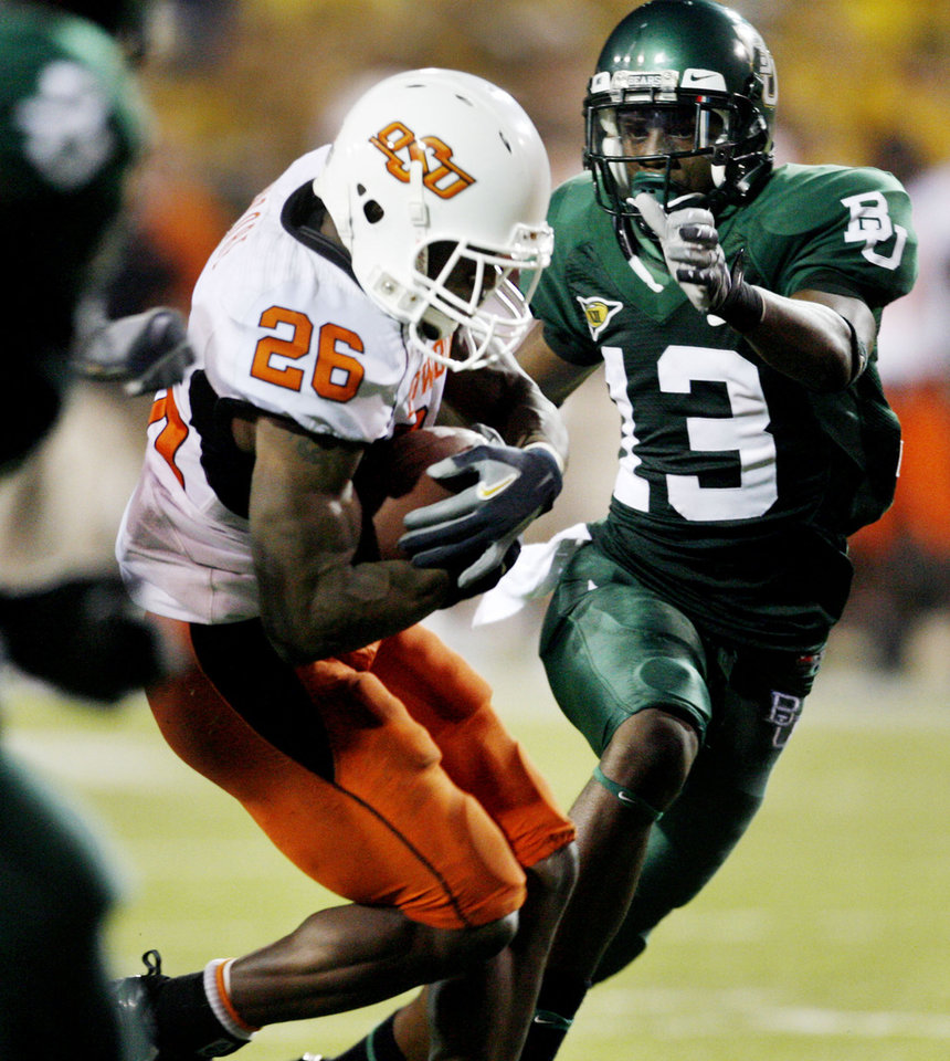 Quinton Moore (26) returns an interception inside the Baylor 20 yard line setting up a touchdown during the second half of the college football game between Oklahoma State University and Baylor University at Floyd Casey Stadium in Waco, Texas, Saturday, Nov. 17, 2007. BY STEVE SISNEY, THE OKLAHOMAN