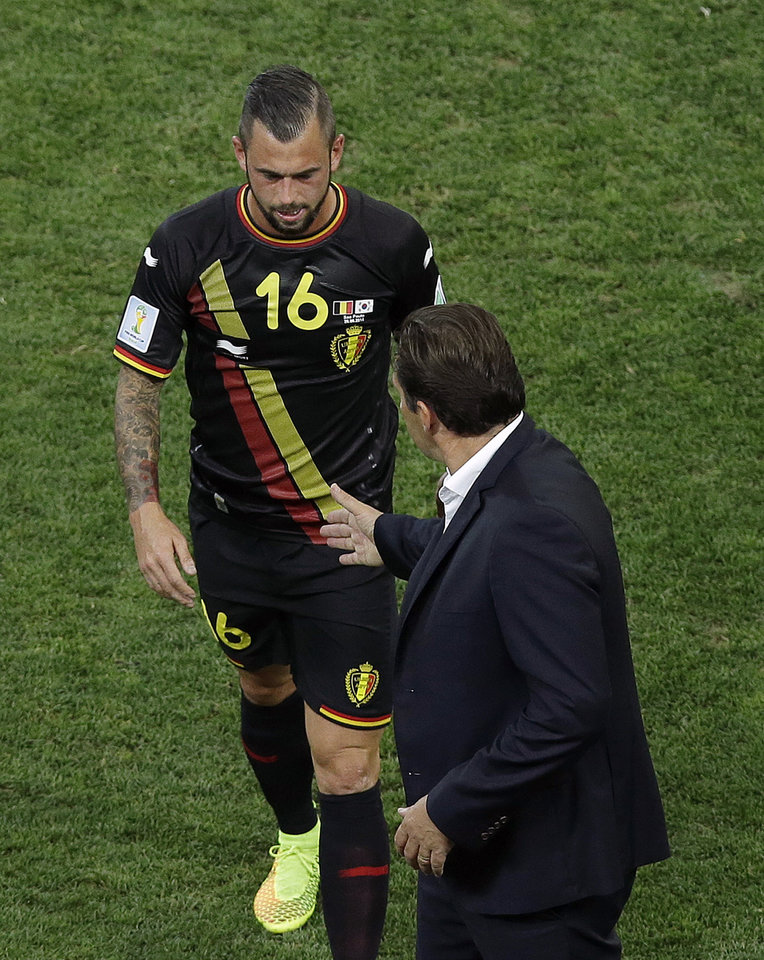 Photo - Belgium's Steven Defour (16) walks off the field and is greeted by Belgium's head coach Marc Wilmots after getting a red card during the group H World Cup soccer match between South Korea and Belgium at the Itaquerao Stadium in Sao Paulo, Brazil, Thursday, June 26, 2014. (AP Photo/Andrew Medichini)