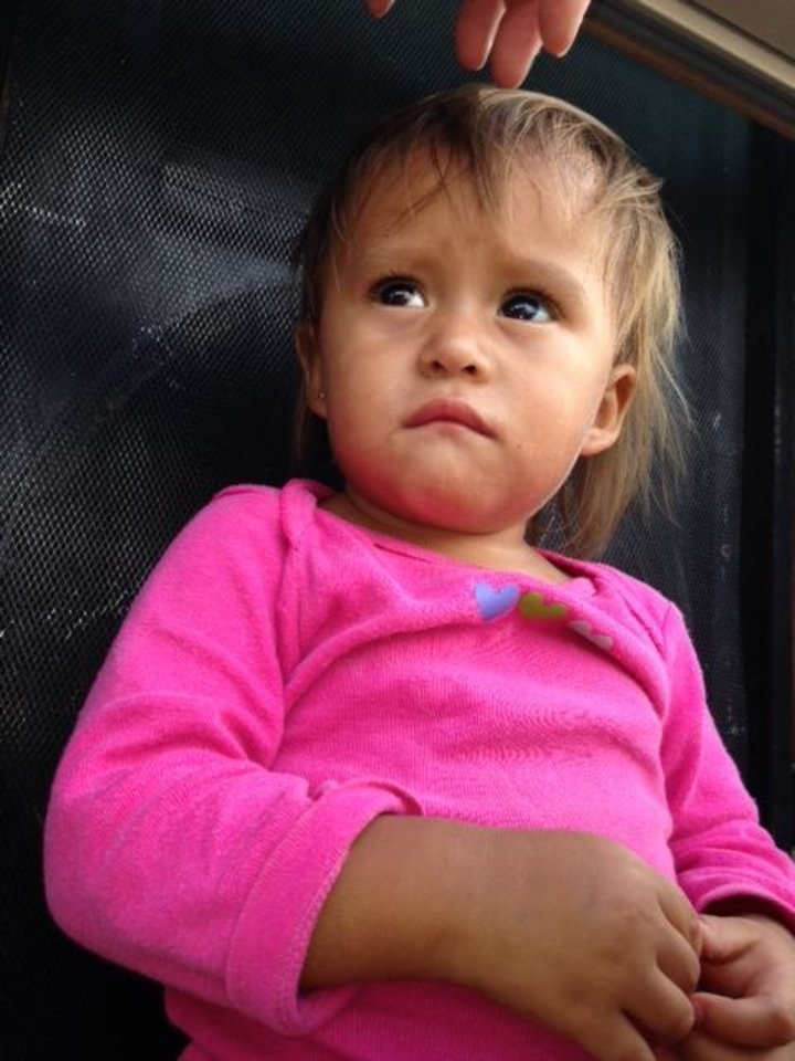 Photo -  One of the children cared for by People Caring for People, an Oklahoma City nonprofit that is on a mission trip at the Mexican border. Photo provided.