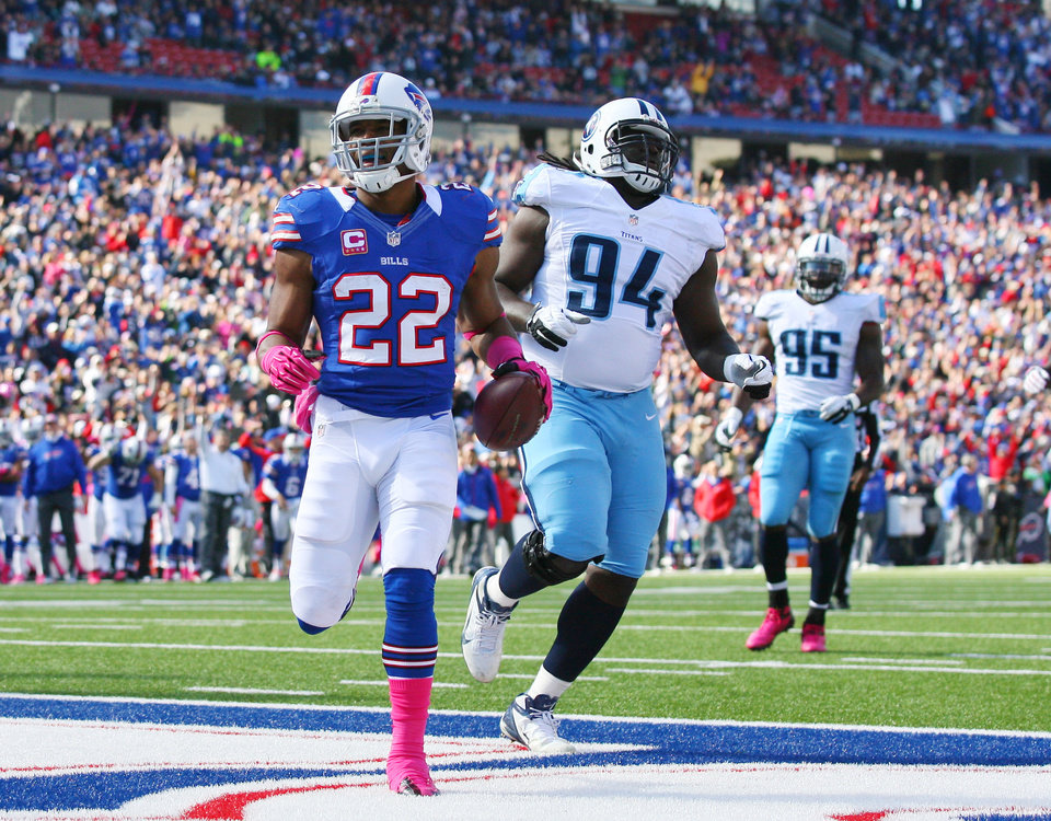 Photo -   Buffalo Bills running back Fred Jackson (22) scores a touchdown in front of Tennessee Titans defensive tackle Sen'Derrick Marks (94) during the first half of an NFL football game in Orchard Park, N.Y., Sunday, Oct. 21, 2012. (AP Photo/Bill Wippert)
