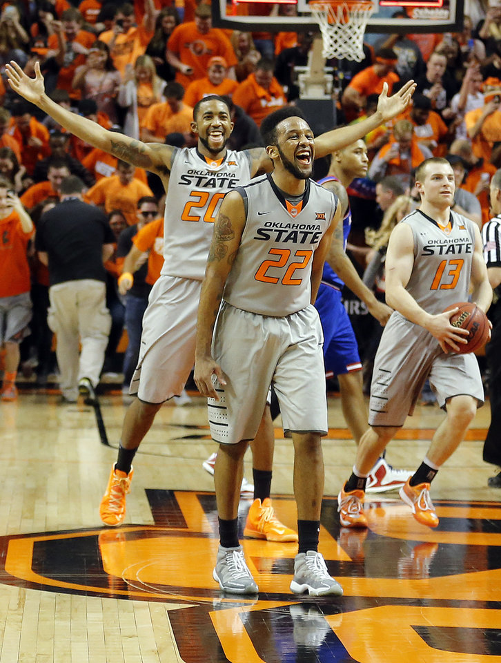 Photo - Oklahoma State's Jeff Newberry (22), Michael Cobbins (20) and Phil Forte III (13) celebrates following the men's college basketball game between Oklahoma State University and the University of Kansas at Gallagher-Iba Arena in Stillwater, Okla.,  Saturday, Feb. 7, 2015. OSU won 67-62. Photo by Sarah Phipps, The Oklahoman