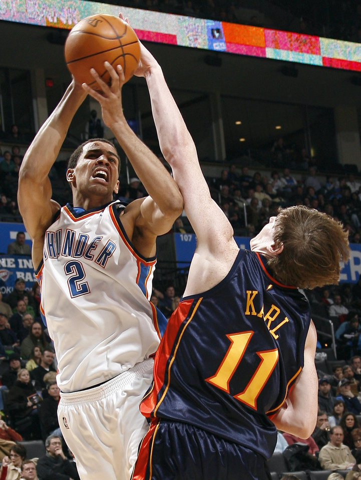Photo - Oklahoma City's Thabo Sefolosha (2) shoots over Golden State's Coby Karl (11) during the NBA game between the Oklahoma City Thunder and Golden State Warriors, Sunday, Jan. 31, 2010, at the Ford Center in Oklahoma City. Photo by Sarah Phipps, The Oklahoman