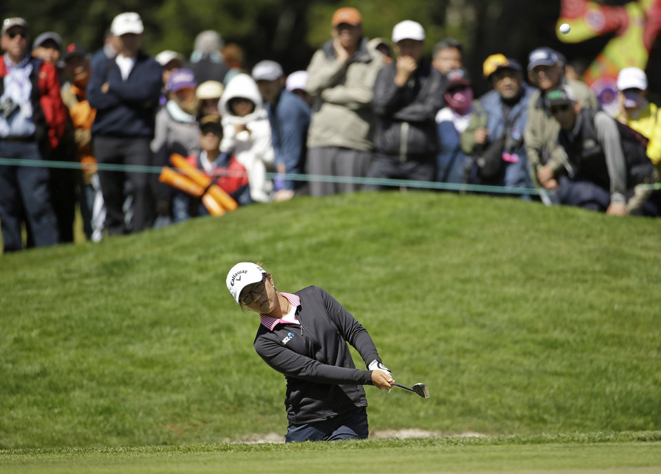 Photo - Lydia Ko, of New Zealand, hits out of a bunker onto the sixth green of Lake Merced Golf Club during the final round of the Swinging Skirts LPGA Classic golf tournament on Sunday, April 27, 2014, in Daly City, Calif. (AP Photo/Eric Risberg)