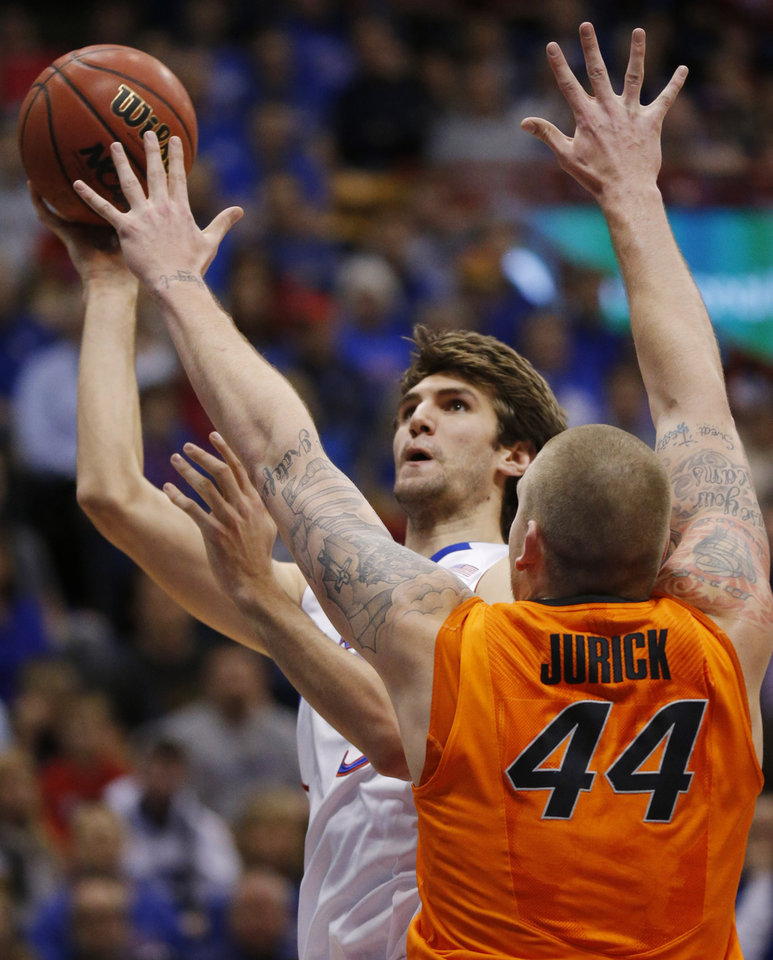 Photo - Kansas center Jeff Withey (5) is fouled by Oklahoma State center Philip Jurick (44) during the first half of an NCAA college basketball game in Lawrence, Kan., Saturday, Feb. 2, 2013. (AP Photo/Orlin Wagner)