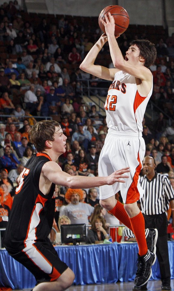 Photo - Cheyenne-Reydon's Austin Thrash (12) shoots over Merritt's Francis Potter (15) during the Class A boys state championship high school basketball game between Cheyenne-Reydon and Merritt at State Fair Arena in Oklahoma City, Saturday, March 3, 2012.  Photo by Nate Billings, The Oklahoman