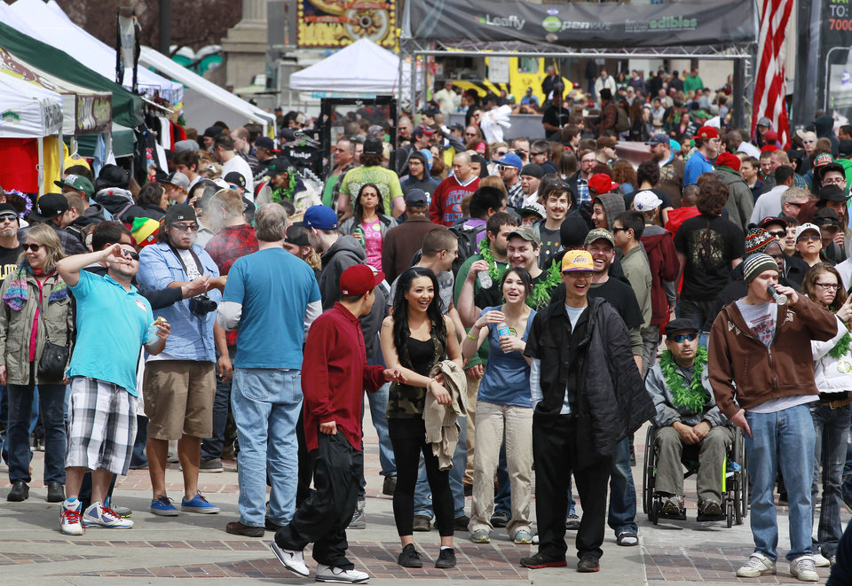 Photo - Crowds begin to gather at the Denver 4/20 pro-marijuana rally at Civic Center Park in Denver on Saturday, April 20, 2013. Authorities generally look the other way at public pot smoking here on April 20. Police said this week they're focused on crowd security in light of attacks that killed three at the finish line of the Boston Marathon. (AP Photo/Brennan Linsley)