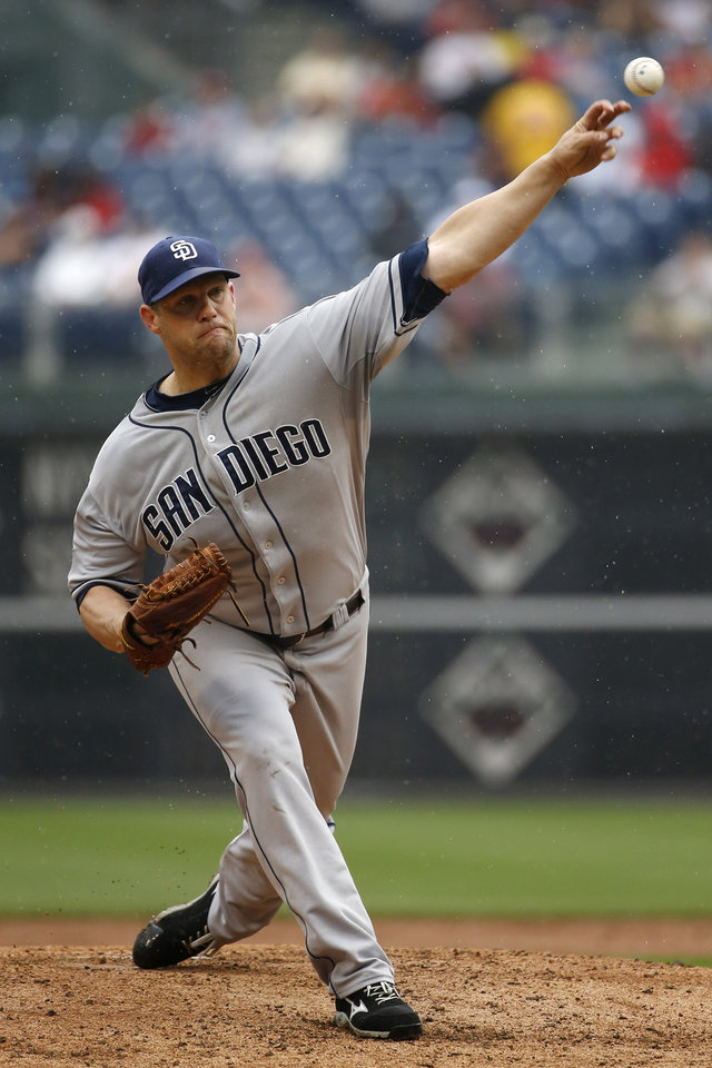 Photo - San Diego Padres' Eric Stults pitches during the third inning of a baseball game against the Philadelphia Phillies, Thursday, June 12, 2014, in Philadelphia. (AP Photo/Matt Slocum)