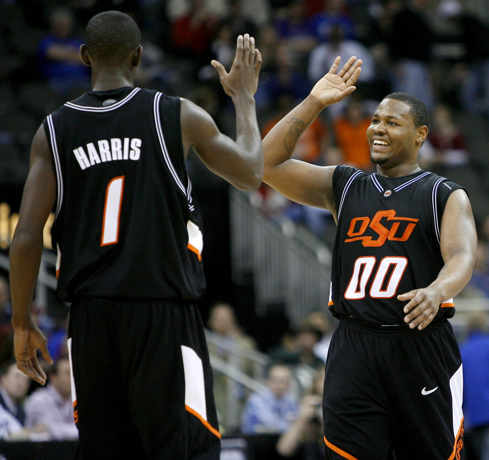 Photo - COLLEGE BASKETBALL, BIG 12 TOURNAMENT, CELEBRATION: OSU's Byron Eaton, right, and Terrel Harris celebrate during the first  round game in the Men's Big 12 Basketball Championship between Oklahoma State University and Texas Tech at The Sprint Center on Thursday, March 13, 2008, in Kansas City, Mo.    BY BRYAN TERRY, THE OKLAHOMAN ORG XMIT: KOD